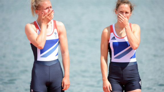 Katherine Copeland and Sophie Hosking of Great Britain cry before receiving their gold medals for the lightweight women