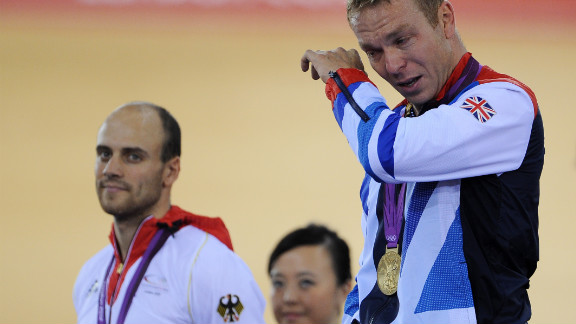 Gold medalist Sir Chris Hoy of Great Britain, right, tears up alongside silver medalist Maximilian Levy during the medal ceremony for the men