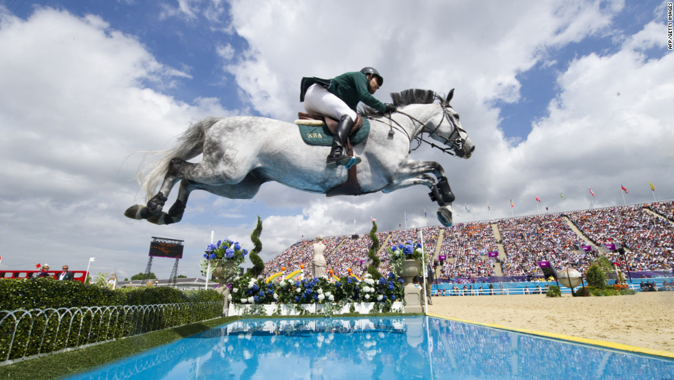 Prince Abdullah Al Saud of Saudi Arabia, on Davos, competes in the individual show jumping final.