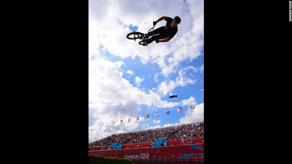 A freestyle BMX rider entertains the crowds during a break in the seeding phase runs.