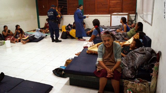 People take refuge from Hurricane Ernesto in a shelter Tuesday in the Mahahual community on Mexico's Yucatan Peninsula.