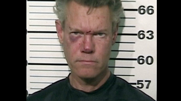 Musician Randy Travis was arrested in 2012 for misdemeanor DWI and felony retaliation after he was involved in a one-vehicle accident and found naked in the road. He was later released on bail.