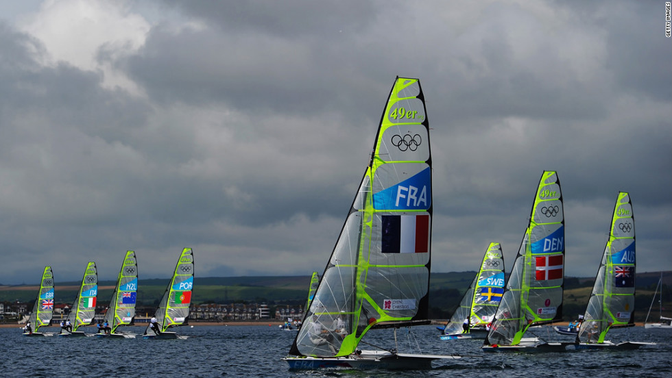 The boats take off for the start of the men's 49er sailing in Weymouth Harbour.