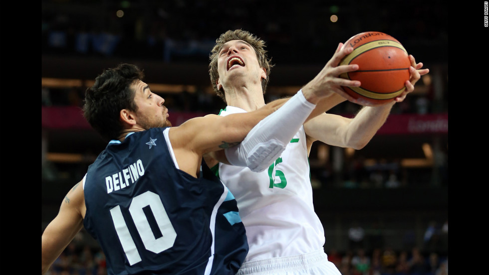 Tiago Splitter of Brazil goes up for a shot against Carlos Delfino of Argentina in the first half of the men's basketball quaterfinal game.