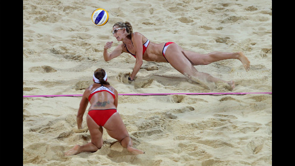 Kerri Walsh Jennings of the United States, top, dives for the ball during the women