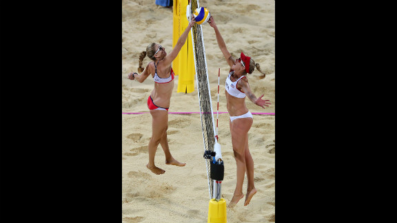 Kerri Walsh Jennings of the United States, left, competes against countryman April Ross during the women