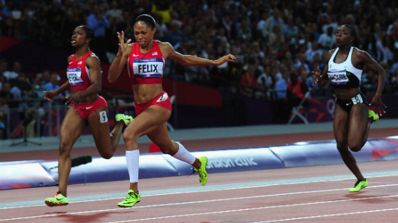 Allyson Felix of the United States crosses the finish line ahead of Murielle Ahoure of Cote d
