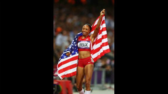 Allyson Felix of the United States celebrates after winning gold in the women
