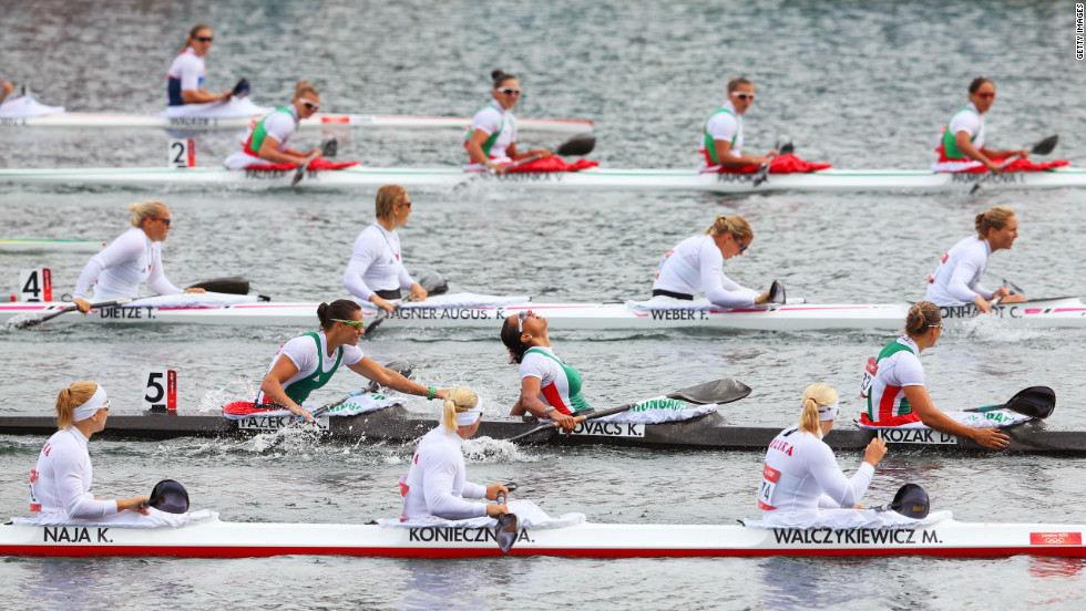 In Boat 5, from left, Hungary's Krisztina Fazekas, Katalin Kovacs and Danuta Kozak celebrate winning the gold medal in the women's kayak four 500-meter sprint final in Windsor.