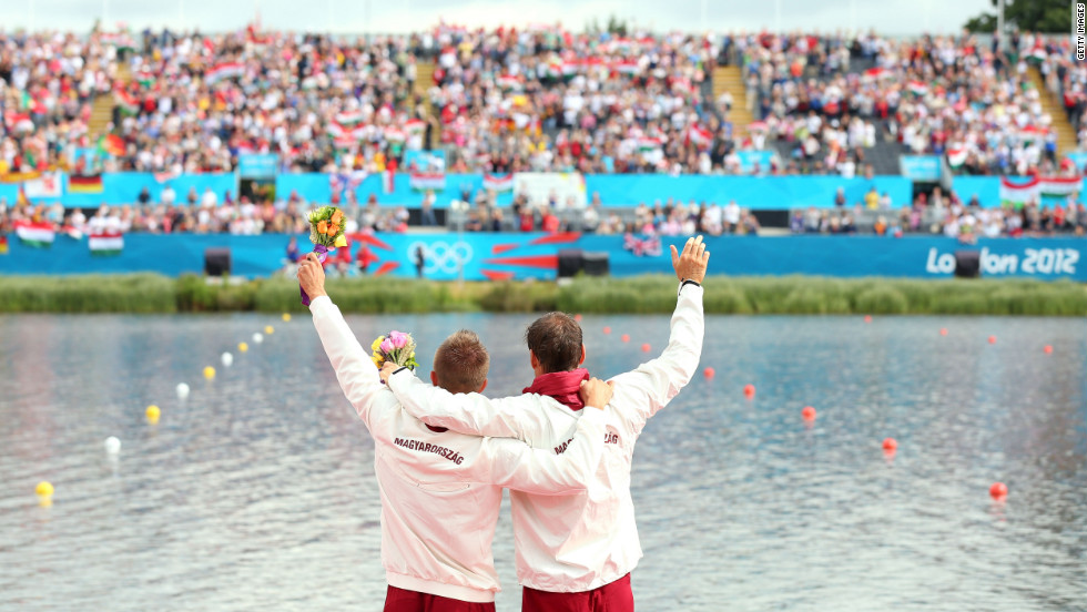 Hungary's Roland Kokeny and Rudolf Dombi celebrate winning gold in the men's kayak double 1,000-meter canoe sprint final in Windsor, England.