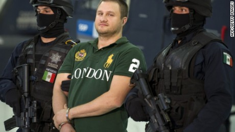 Edgar Valdez Villareal aka 'La Barbie' (C) of the Beltran Leyva drug cartel, is presented to the press at the Federal Police headquarters in Mexico City, on August 31, 2010.