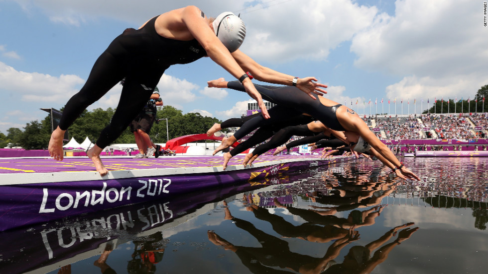 Germany's  Angela Maurer, left, and and Spain's Erika Villaecija Garcia dive in to start the women's marathon 10-kilometer swimming.