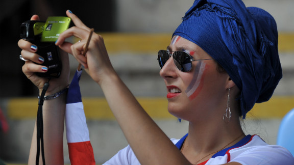 A fan of the French football team snaps some action during the women
