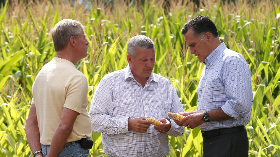 Mitt Romney visits a cornfield in Des Moines, Iowa, on Wednesday as his campaign struggles to gain momentum..