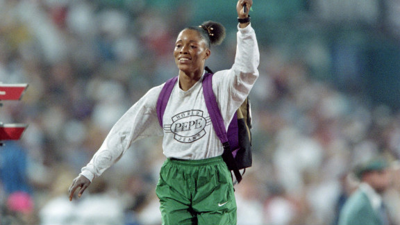 Ajunwa waves the Nigerian flag after winning the gold medal with a 7.12m jump on August 2 1996.