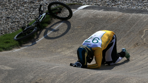Australian rider Khalen Young lies on the ground after crashing during the men