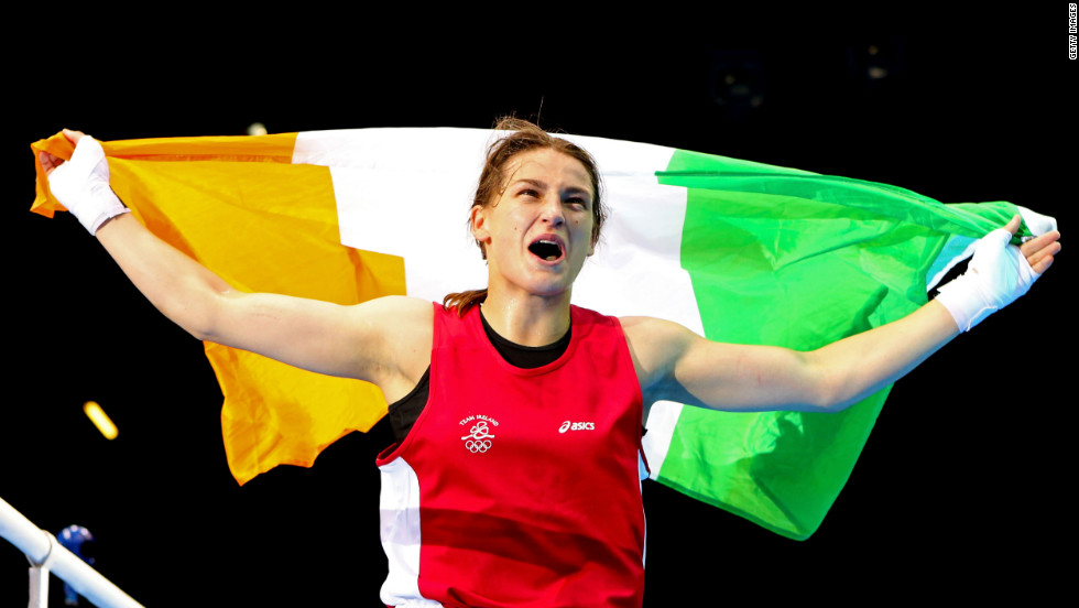 Ireland's Katie Taylor celebrates winning her bout against Sofya Ochigava of Russia during the women's light (60kg) boxing final at ExCeL arena in London. As well as taking the Olympic gold for Ireland, she also became the first ever Olympic female lightweight champion.