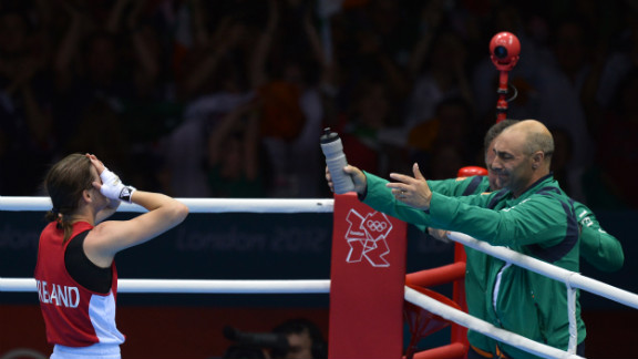 Katie Taylor of Ireland celebrates her defeat of Sofya Ochigava of Russia to win gold during the women