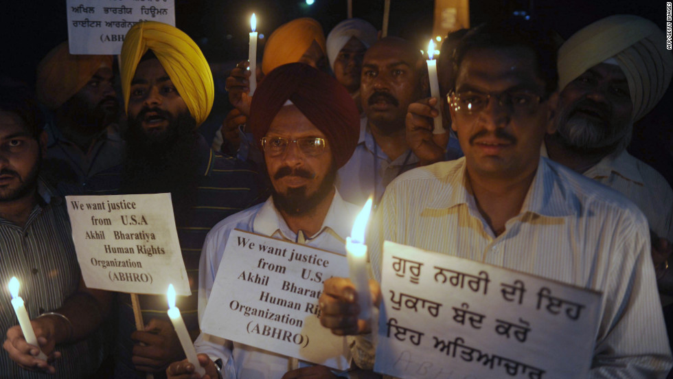 Members of the Akhil Bharatiya Human Rights Organization hold placards and candles during a vigil in Amritsar, India, on Tuesday, August 7, as they pay tribute to Sikh devotees killed in the U.S. The tragedy of the Wisconsin Sikh temple shooting has reverberated worldwide.