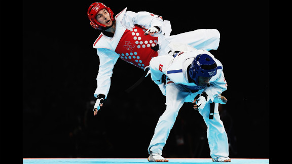 Martin Stamper of Great Britain competes against Servet Tazegul of Turkey during the men