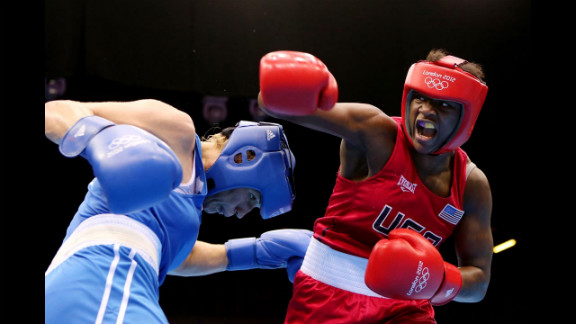 Claressa Shields, in red, battles Nadezda Torlopova of Russia during the women