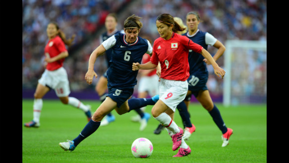 U.S. defender Amy LePeilbet, left, fights for the ball with Japanese midfielder Nahomi Kawasumi during the final of the women