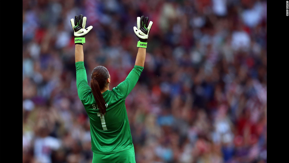 Goalkeeper Hope Solo of the United States reacts after Carli Lloyd scored a goal in the first half.
