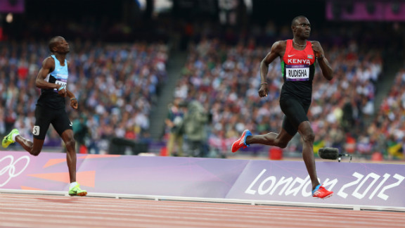 David Lekuta Rudisha of Kenya approaches the finish line ahead of Nijel Amos of Botswana to win gold and set a world record in the men