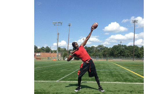 """Tariq Rasheed Ali, a """"huge Usain Bolt fan"""" and a personal trainer, strikes the Bolt pose at Virginia Tigers full contact flag football practice at Bryant Alternative High School in Alexandria, Virginia."""