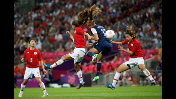 Forward Alex Morgan of the United States battles for the ball during Thursday
