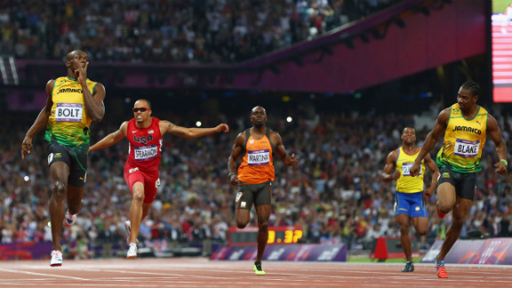 Usain Bolt of Jamaica celebrates as he crosses the finish line ahead of Wallace Spearmon of the United States, Churandy Martina of Netherlands, Yohan Blake of Jamaica and Alex Quinonez of Ecuador to win gold in the men