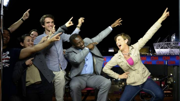 CNN's Becky Anderson, right, gold medal-winning sprinter and CNN contributor Linford Christie, center, and the CNN production team strike the Bolt pose.