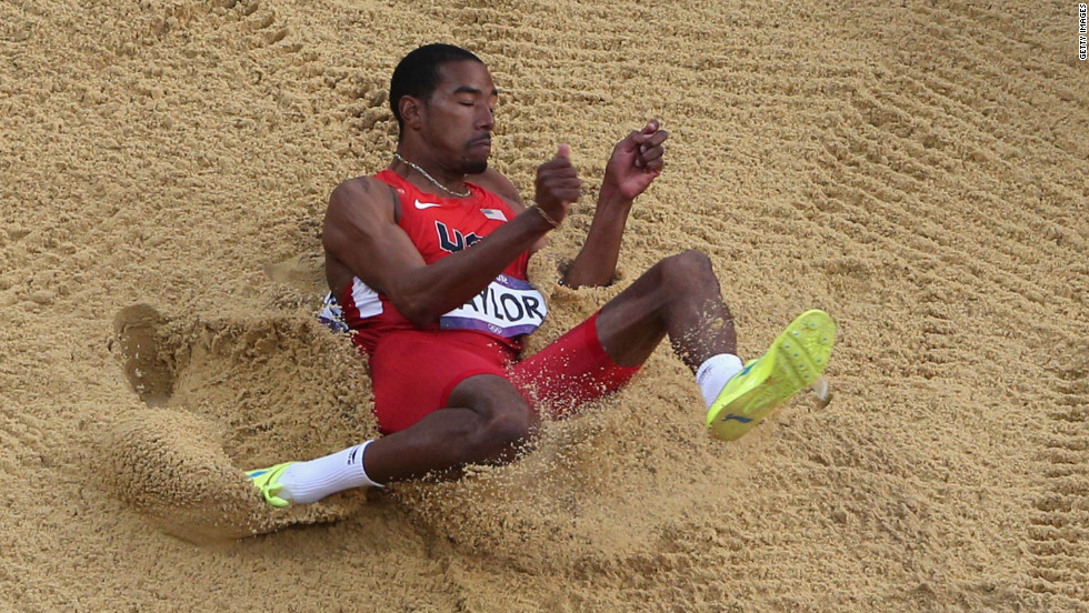 Christian Taylor lands during the triple jump final on Thursday.