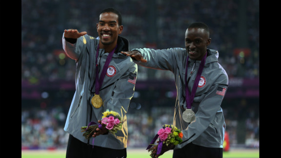 Gold medalist Christian Taylor and silver medalist Will Claye, also of the United States, celebrate during the medal ceremony for the men