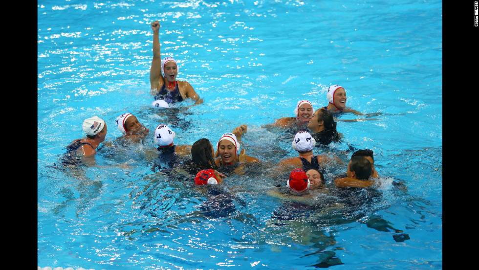 The U.S. team celebrates its gold medal win at the Water Polo Arena in London.