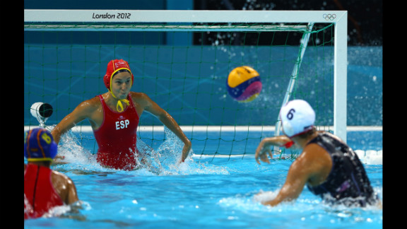 Maggie Steffens of the United States shoots and scores a goal against Spain in the women
