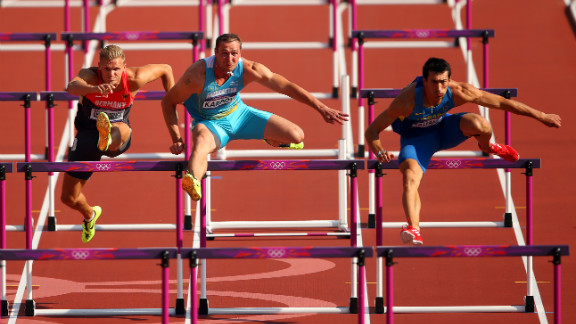 From left, Pascal Behrenbruch of Germany, Dmitriy Karpov of Kazakhstan and Oleksiy Kasyanov of Ukraine race during the men