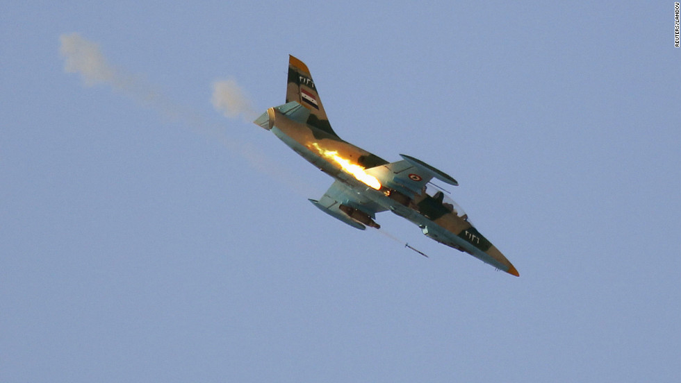 A Syrian air force fighter plane fires during an airstrike Thursday in Tel Rafat, north of Aleppo. Forces loyal to the regime have been shelling Aleppo, Syria's largest city.