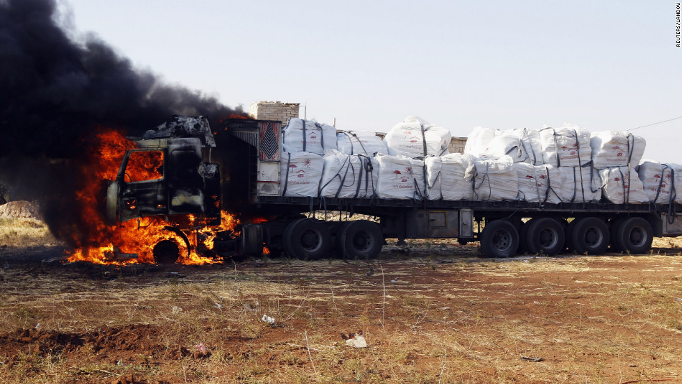 A truck burns after apparently being hit by rockets during an airstrike on Tel Rafat.