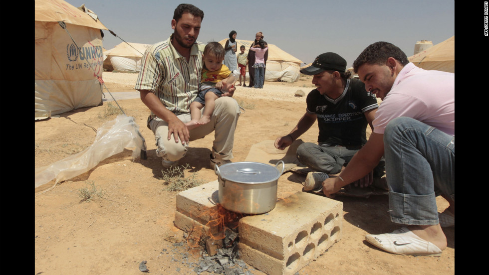 Syrian refugees cook a meal at Al Zaatari camp in Mafraq, Jordan.