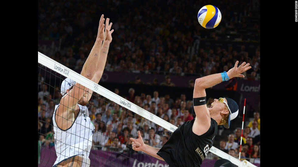 "Germany's right blocker Jonas Reckermann, right, jumps  in front of Brazil's left blocker Alison Cerutti, left, during the men's beach volleyball final match on Thursday, August 9, in London. <a href=""http://www.cnn.com/2012/08/08/worldsport/gallery/olympics-day-twelve/index.html"">Check out Day 12 of competition</a> from Wednesday, August 8. The Games ran through Sunday."