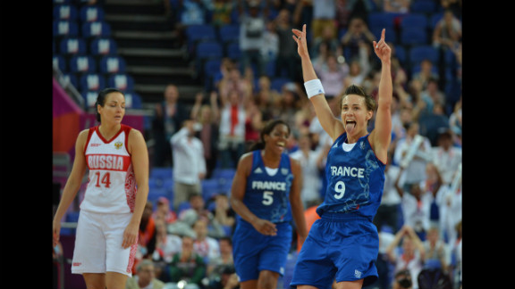 French guard Celine Dumerc celebrates after winning 81-64 against Russia during the women