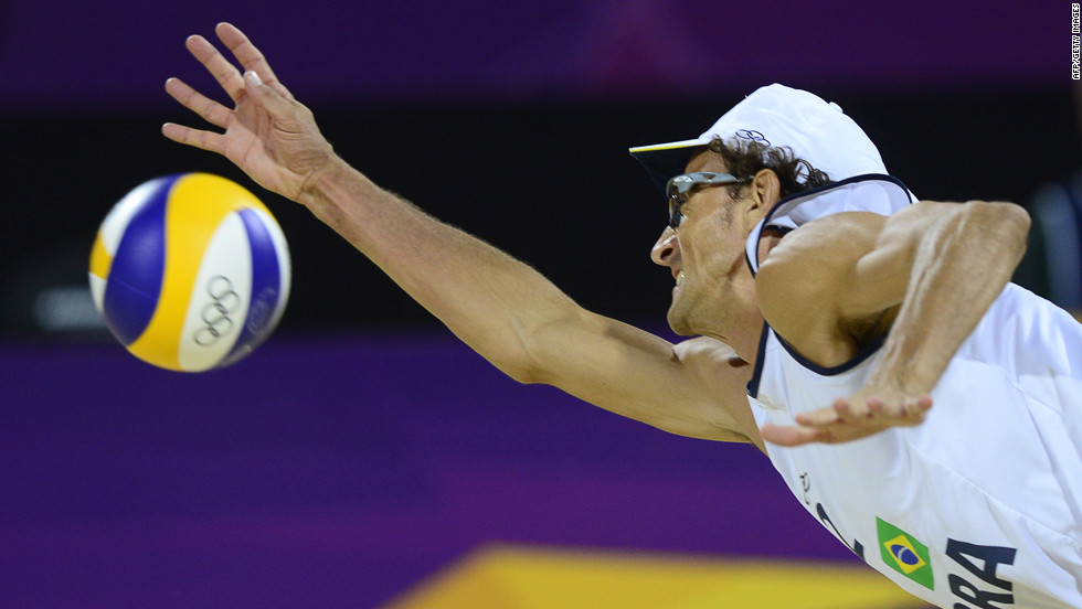 Brazil's right defender Emanuel Rego jumps to return the ball during the men's beach volleyball final match against Germany.