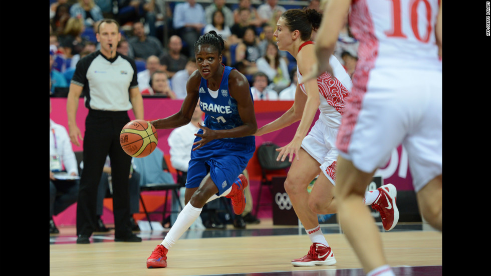 French guard Emilie Gomis, left, is seen in action during the London 2012 Olympic Games women's semifinal basketball game between Russia and France.