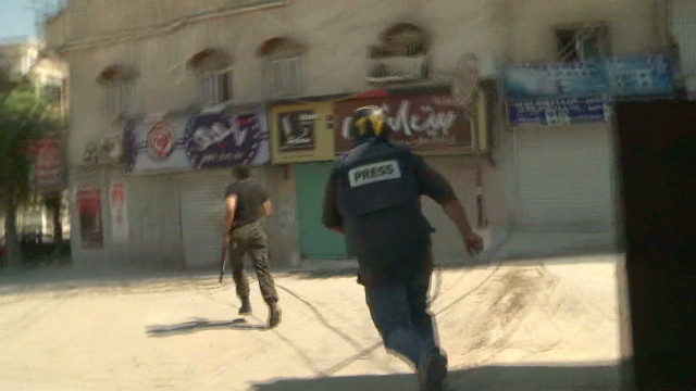 Watch reporter dodge danger in Syria