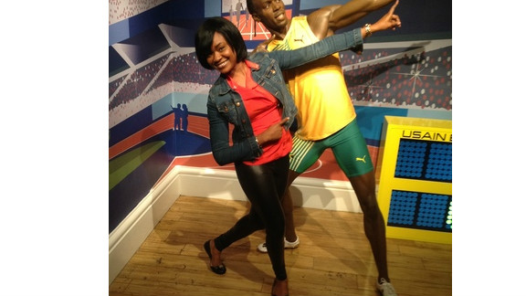 Ehimhen Okoh is on vacation in London and had her boyfriend shoot this picture of her at Madame Tussauds wax museum in front of Usain Bolt's new statue.