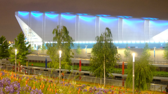 The Water Polo Arena, seen beyond the River Lea, is the first dedicated water polo venue to be built for an Olympic Games. Its components will be reused or recycled after the Games.
