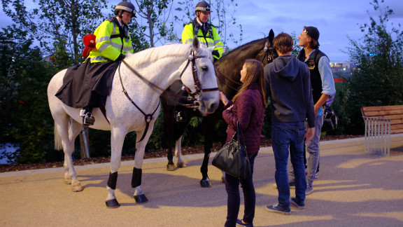 In the absence of large crowds, mounted police officers had time to chat to spectators - who took the opportunity to admire their horses, too.