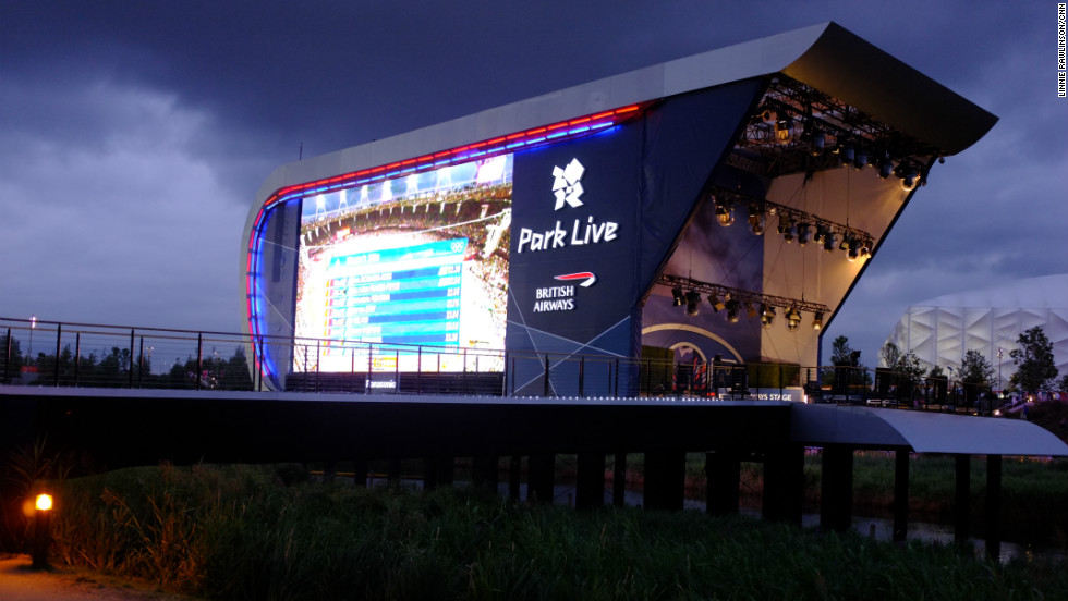 Though night was falling, and a little rain was too, the live broadcast in the Olympic Park continued ...
