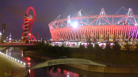 The stadium and the Orbit stood out against the cloudy East London sky and reflected in the River Lea, which flows through the park. The stadium was hosting athletics that night.